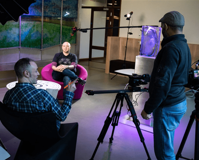two video directors discussing during an online video shooting